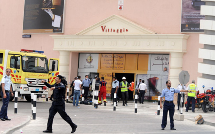 Security clear the entrance to Villagio mall in Doha, Qatar after a fire. Picture: AFP