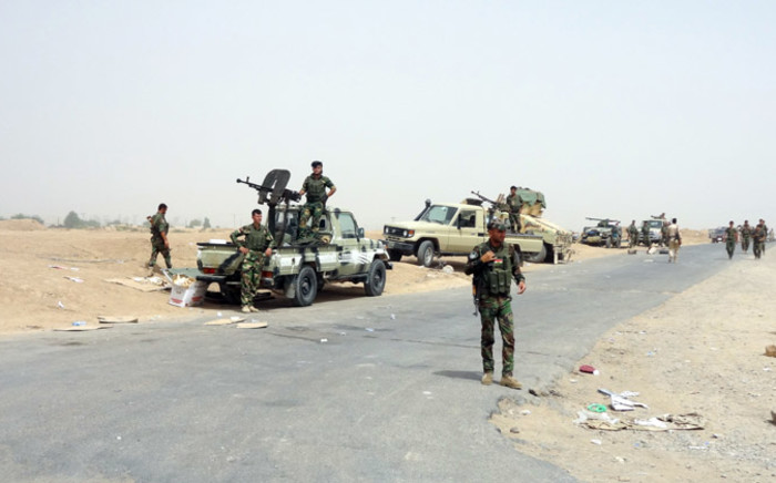 Kurdish Iraqi Peshmerga forces deploy their troops and armoured vehicles on the outskirts of the multi-ethnic city of Kirkuk, only 1 km away from areas controlled by Sunni Muslim Jihadists from the Islamic State of Iraq and the Levant (ISIL) in northern Iraq on 12 June, 2014. Picture: AFP.