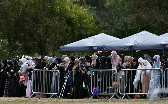 Mourners offer funeral prayers for Khalid Mustafa and his son Hamza Mustafa, slain by an Australian white supremacist gunman who shot down 50 Muslims at two mosques, at the Memorial Park cemetery in Christchurch on 20 March 2019. Picture: AFP