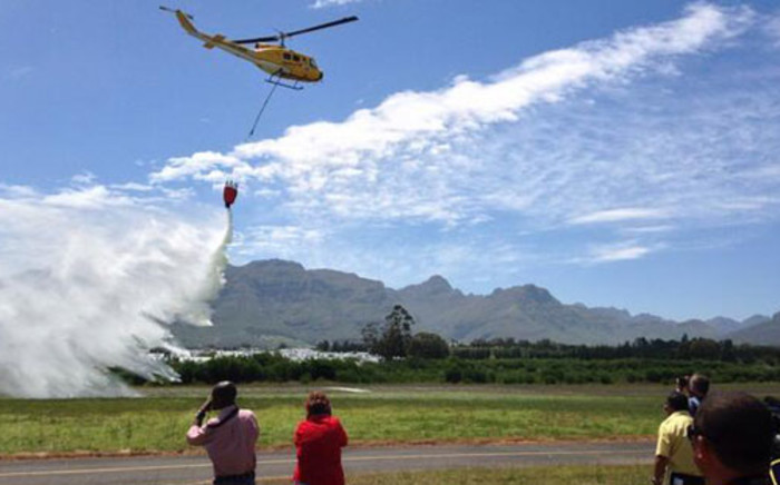 Workings on Fire crew members demonstrate their firefighting capabilities at the launch of the Cape fire season. Picture: Rafiq Wagiet/EWN.