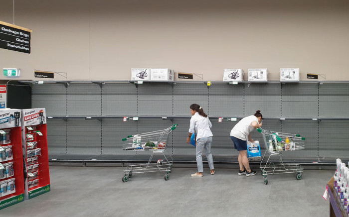 FILE: Empty toilet paper shelves as shoppers start stockpiling amid the coronavirus pandemic. Picture: www.123rf.com