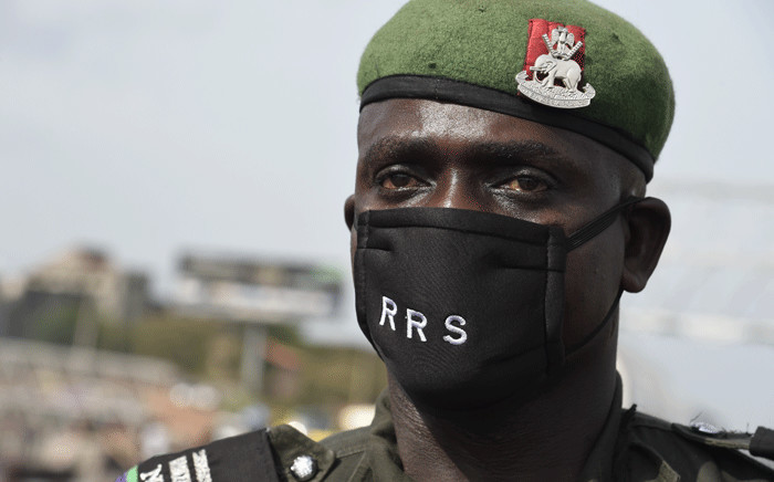 FILE: A police officer wears face mask customised for the anti-robbery Rapid Respond Squad (RRS) as a preventive measure against the COVID-19 coronavirus at a check point in Lagos, on 20 April 2020.  Picture: AFP