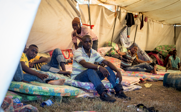 Young Malawian men sit inside their tent in the Isipingo camp on 25 April 2015, which was a temporary home for people displaced by xenophobic violence in Durban. Picture: Aletta Gardner/EWN