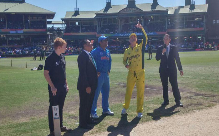 Australia captain Michael Clarke and India's skipper Mahendra Singh Dhoni with the commentary team during the toss ahead of their World Cup semifinal clash on 26 March 2015. Picture: Cricket Australia.