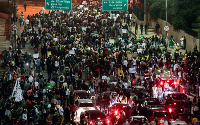 Demonstrators march during a demonstration in Sao Paulo, Brazil, on June 20, 2013, during a protest of what is now called the 'Tropical Spring' against corruption and price hikes.  Picture: AFP.