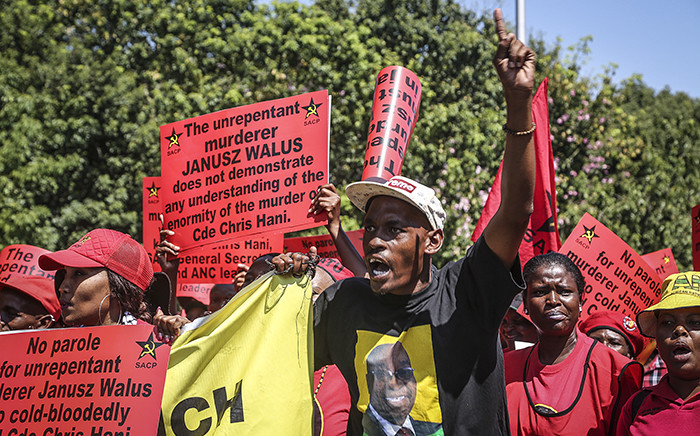 FILE: Tripartite alliance supporters hold up placards during a march through Pretoria's CBD in support of Justice Minister Michael Masutha's decision to appeal the parole granted to Chris Hani's killer, Janusz Waluś. Picture: Reinart Toerien/EWN.