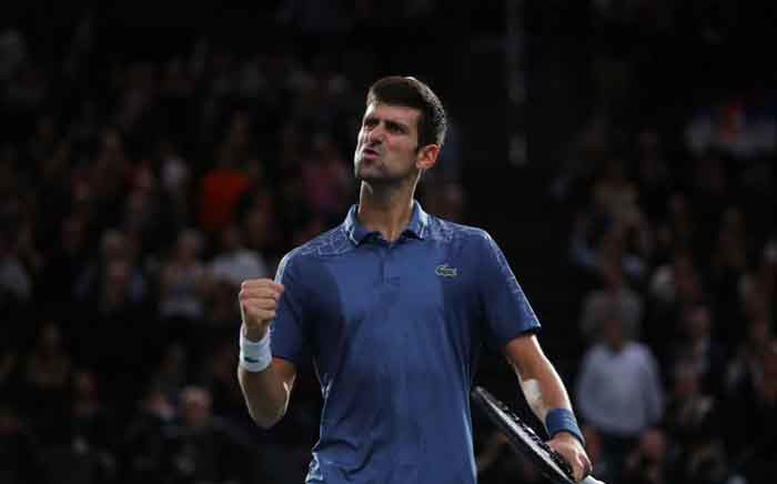 Serbia's Novak Djokovic celebrates after winning his semifinal match against Switzerland's Roger Federer. Picture: @RolexPMasters/Twitter.