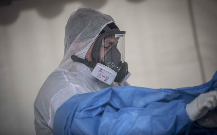 A healthcare worker removing PPE at the Nasrec Field Hospital in Johannesburg. Picture: Abigail Javier/Eyewitness News