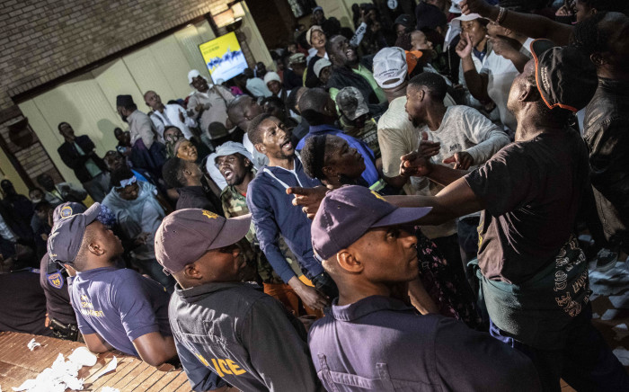Residents of Alexandra disrupt Johannesburg Mayor Herman Mashaba's address at the Marlboro community hall on 15 April 2019. Picture: Abigail Javier/EWN