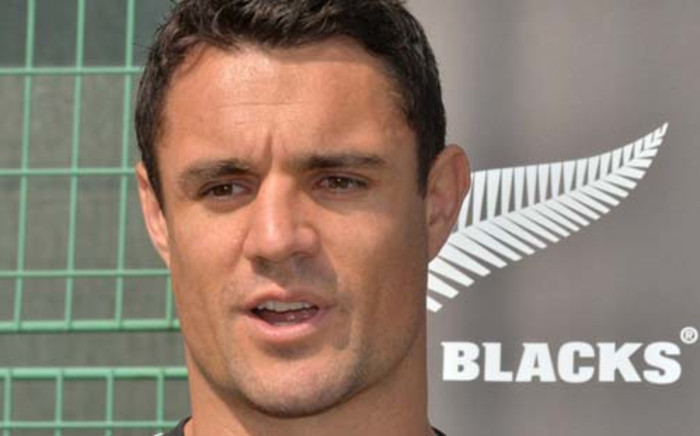 New Zealand's All Blacks player Daniel Carter answers questions during a meeting with the media as part of their visit to Aoyama elementary school in Tokyo on November 1, 2013. Picture: AFP.