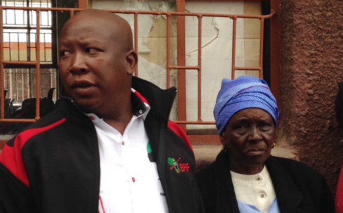 EFF leader Julius Malema and his Grandmother Sarah stand holding hands in the queue at Mpongele primary school in Seshego near Polokwane in Limpopo. Picture: Reinart Toerien/EWN