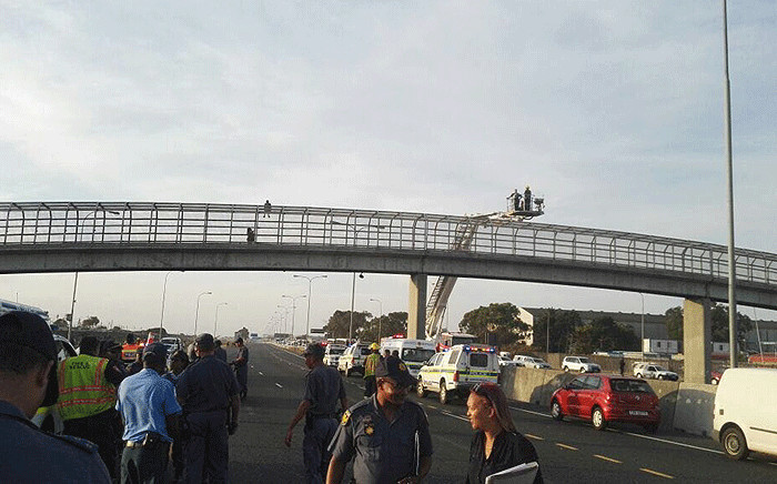 Officials pictured on scene at the footbridge at Borcherds Quarry near Cape Town International Airport, where a man threatened to commit suicide on 19 January 2018. Picture: Supplied.