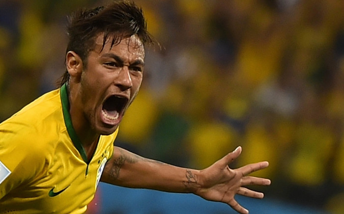 Brazil's forward Neymar celebrates scoring during a Group A football match between Brazil and Croatia at the Corinthians Arena in Sao Paulo during the 2014 FIFA World Cup on June 12, 2014.  Picture: AFP