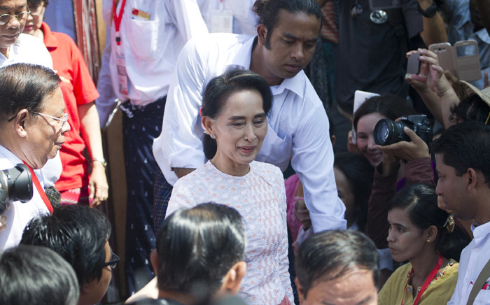 Myanmar opposition leader Aung San Suu Kyi leaves the headquarters of the National League of Democracy (NLD) after addressing a small crowd and the media in Yangon on 9 November, 2015. Picture: AFP.