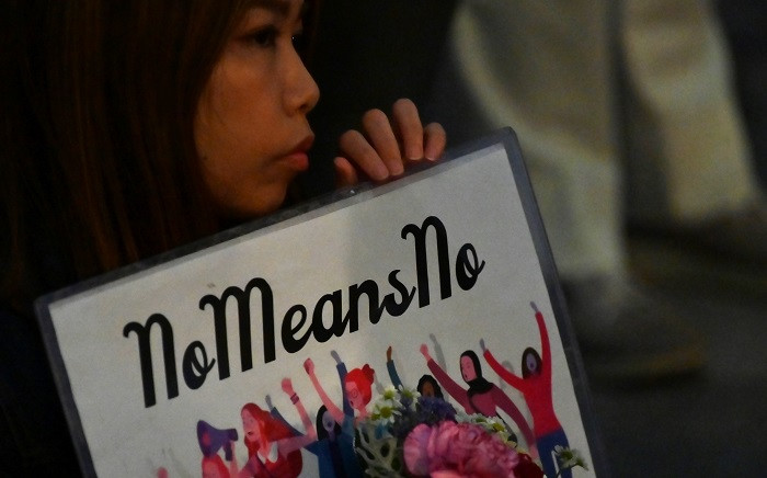 A demonstrator holds a placard during a protest against the lack of substantial legal protection for sexual assault victims in Tokyo on 11 June 2019. Picture: AFP