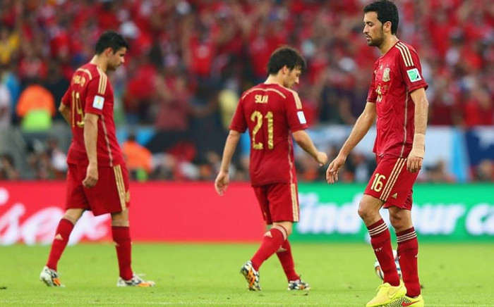 Spain's Diego Costa (L), David Silva (C) and Sergio Busquets look dejected after conceding the second goal in their World Cup match against Chile. Spain lost 2-0. Picture: Facebook.com