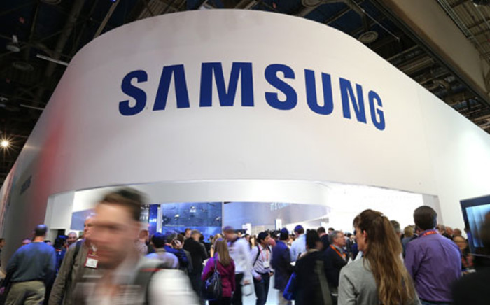 ttendees pass by the Samsung booth during the 2013 International CES at the Las Vegas Convention Center on January 8, 2013 in Las Vegas, Nevada.Picture: AFP.