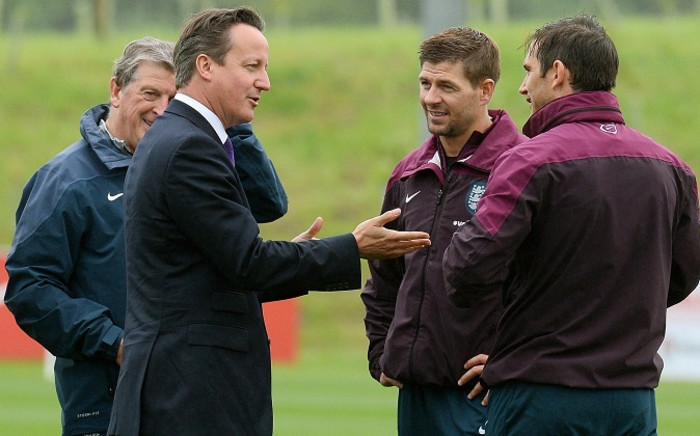 British Prime Minister David Cameron chats to England coach Roy Hodgson, and footballers Steven Gerrard and Frank Lampard. Picture: Facebook.com