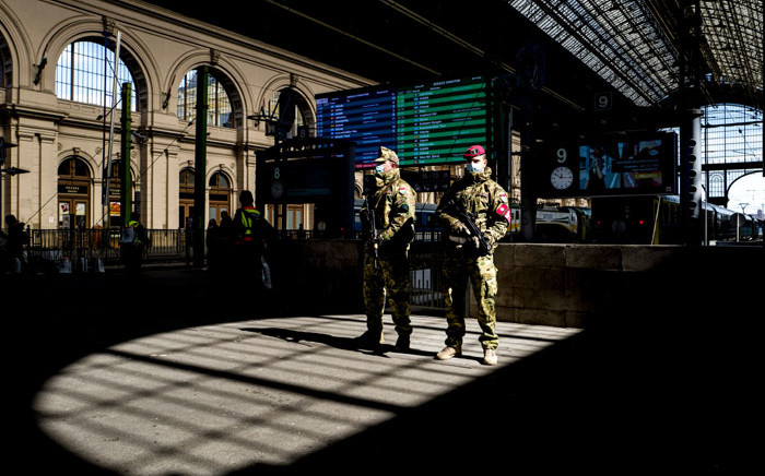 FILE: Hungarian soldiers stand on guard wearing protective masks in front of the Keleti (Eastern) railway station in Budapest, amid the spread of the novel coronavirus COVID-19 pandemic on 24 March 2020. Picture: AFP