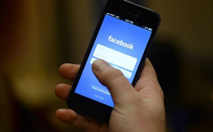 FILE: The Facebook app on a smartphone. Picture: AFP