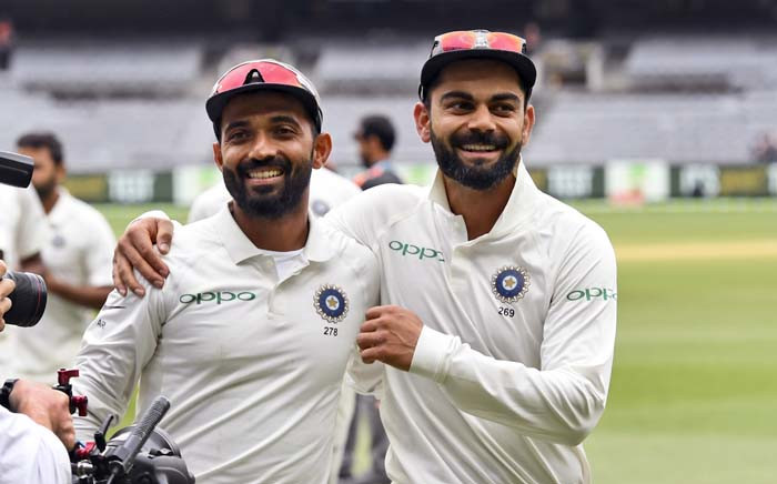 India's captain Virat Kohli (R) and Ajinkya Rahane (L) celebrate on the final day of the third cricket Test match between Australia and India in Melbourne on 30 December 2018. Picture: AFP