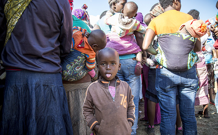 FILE: A little girl waits for her mother to receive supplies at a camp for displaced foreign nationals in Primrose on 18 April 2015. Picture: Thomas Holder/EWN.