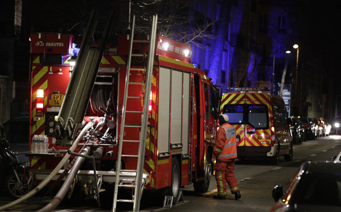 Firefighters are seen near a building that caught fire in the 16th arrondissement in Paris, on 5 February 2019. Picture: AFP