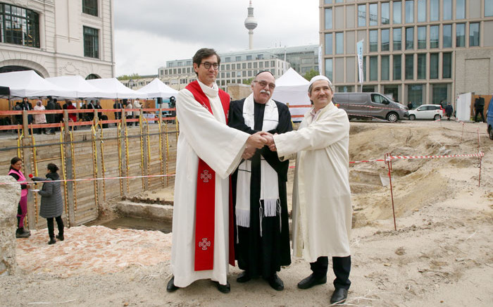 """(Left to right) Pastor Gregor Hohberg, Rabbi Andreas Nachama and Imam Kadir Sanci pose during the groundbreaking ceremony of the multi-religion building """"House Of One"""" on 27 May 2021. The """"House of One"""" is planned as a sacral building with a synagogue, church and mosque in Berlin. Picture: Wolfgang Kumm/AFP"""