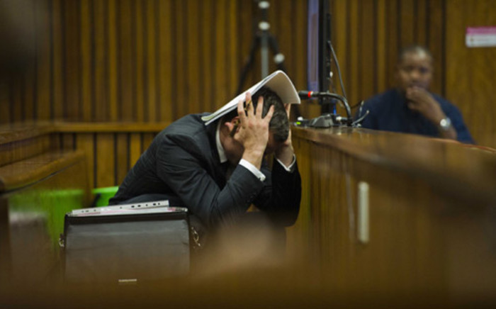 Oscar Pistorius reacts during his murder trial at the High Court in Pretoria on 13 March 2014. Picture: Pool.