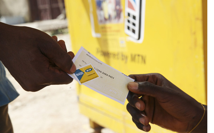 A vendor sells MTN airtime at an MTN office in Abuja, Nigeria. Picture: EPA/Tony Nwosu.