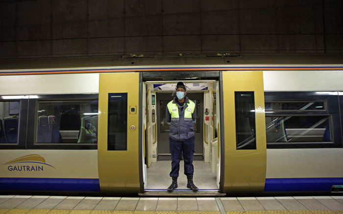 FILE: A Gautrain security official is seen standing at the door of the train at the Hatfield Station in Pretoria. Picture: AFP