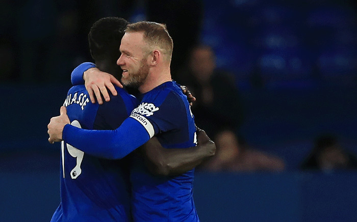 Everton's English striker Wayne Rooney (R) and Everton's Senegalese striker Oumar Niasse react at the final whistle during the English Premier League football match between Everton and Crystal Palace at Goodison Park in Liverpool, north west England on 10 February 2018. Picture: AFP.