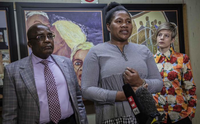Marriage fraud victim Nomathamsanqa Swartbooi speaks to the media after Home Affairs Minister Aaron Motsoaledi apologizes to her for what happened to her. Advocate Erin-Diane Richards stands next to her. Picture: Abigail Javier/EWN