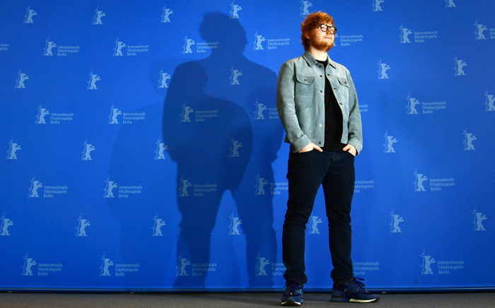 """British singer-songwriter Ed Sheeran poses during a photocall for the film """"Songwriter"""" presented in the """"Berlinale special gala"""" category during the 68th edition of the Berlinale film festival in Berlin on 23 February 2018. Picture: AFP"""