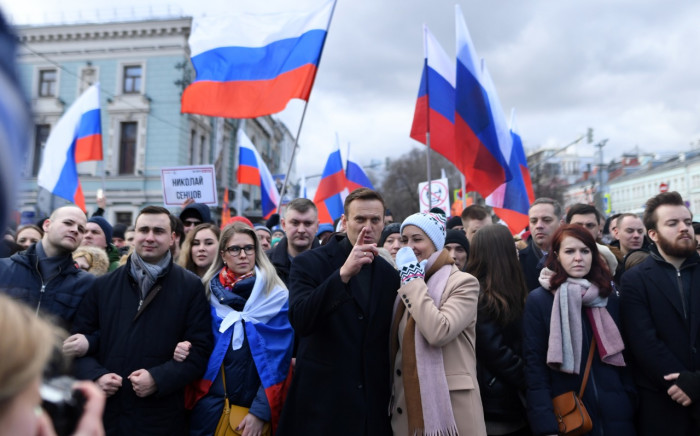 Russian opposition leader Alexei Navalny, his wife Yulia, opposition politician Lyubov Sobol and other demonstrators take part in a march in memory of murdered Kremlin critic Boris Nemtsov in downtown Moscow on 29 February 2020. Picture: Kirill Kudryavtsev/AFP