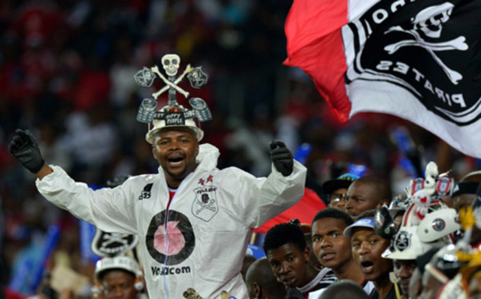 Orlando Pirates' supporters cheer during the African Champions League first leg final between South Africa's Orlando Pirates and Egypt's Al-Ahly in Soweto on November 2, 2013. Picture:AFP