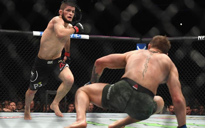 UFC fighter  Khabib Nurmagomedov goes after opponent Conor McGregor during their match on 6 October. Picture: AFP
