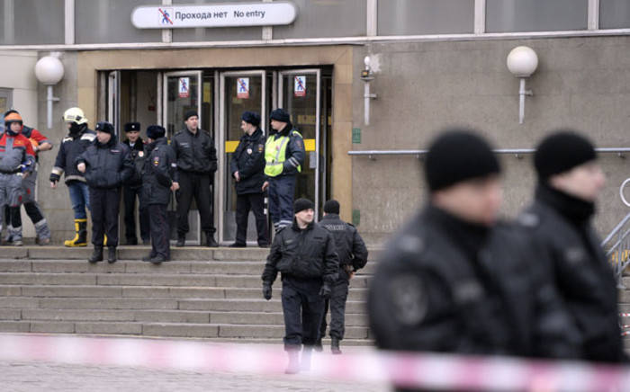 File: Police officers guard the entrance to Sennaya Square metro station in Saint Petersburg on 3 April 2017 after a suicide bomber killed at least 11 people and injured dozens. Picture: AFP.