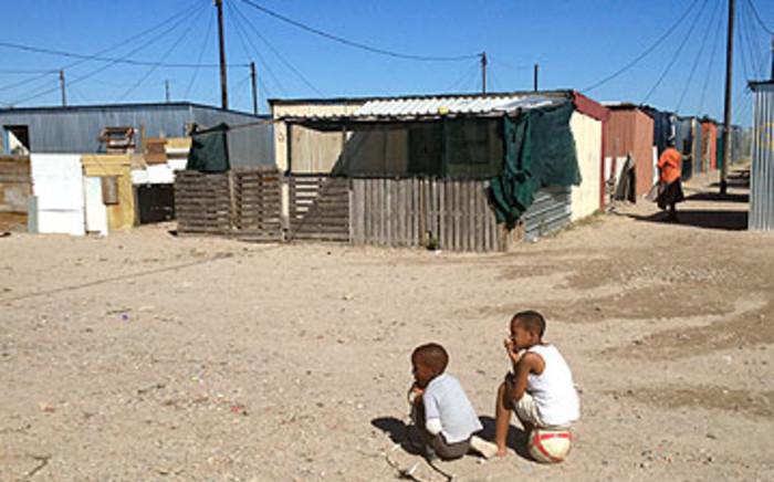 Two non-school going boys while away the hours in Blikkiesdorp. Picture: Aletta Gardner/EWN