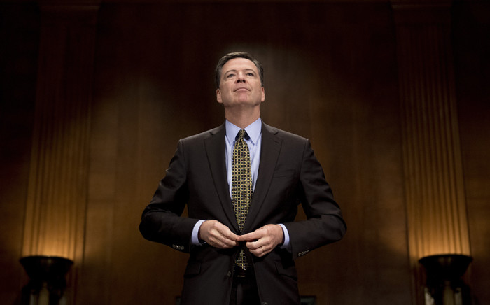 This file photo taken on 3 May 2017 shows former FBI Director James Comey as he prepares to testify before the Senate Judiciary Committee on Capitol Hill in Washington, DC. Picture: AFP.