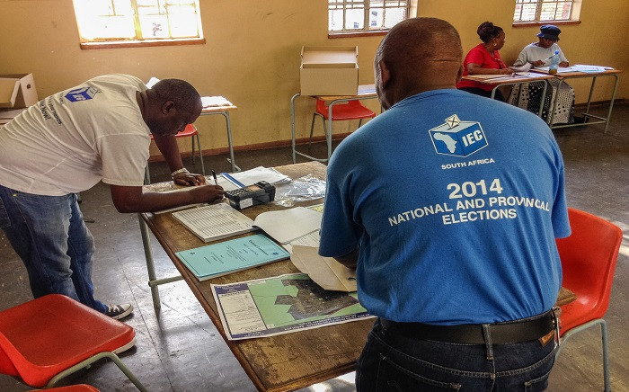 IEC officials prepare to receive people registering to vote at the Orlando West Secondary School in Soweto. Picture: Reinart Toerien/EWN