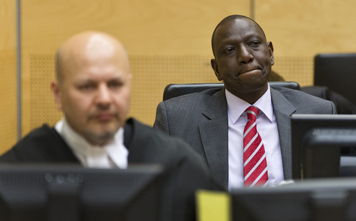 This file photo taken on 10 September, 2013 shows Kenya's Deputy President William Ruto reacting as he sits in the courtroom before the trial at the International Criminal Court (ICC) in The Hague. Picture: AFP.