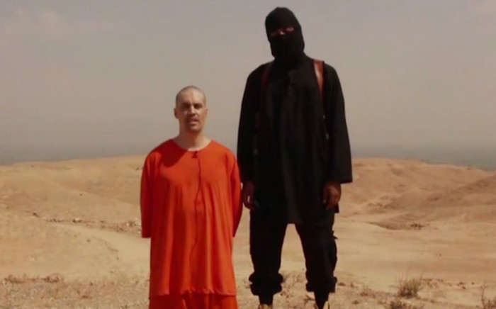 A screengrab of the gruesome video of James Foley ahead of his beheading by Isis militants in Syria. Picture: CNN.