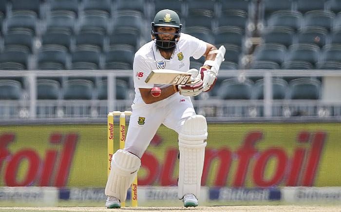 Proteas batsman Hashim Amla keeps an eye on his shot. Picture: AFP