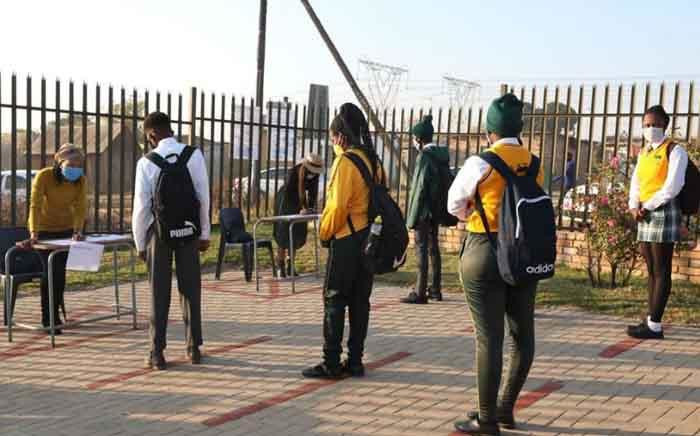 Students queue at Olivenhoutbosch Secondary School before they enter the premises on their first day back on 8 June 2020. Picture: Gauteng Provincial Government.