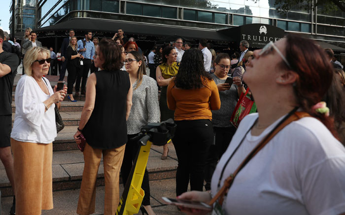People wait outside after evacuating office buildings after an earthquake struck south of Cuba on 28 January 2020 in Miami, Florida. Picture: AFP