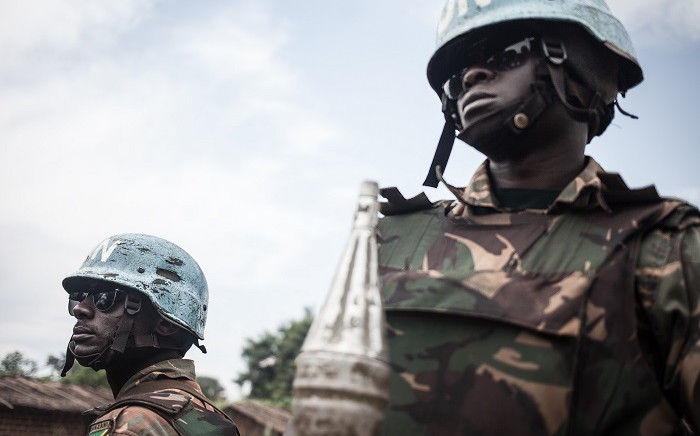 FILE: Tanzanian soldiers from the UN peacekeeping mission in the Central African Republic (MINUSCA), patrol the town of Gamboula, threatened by the Siriri group, on July 6, 2018.  Picture: Florent Vergnes / AFP