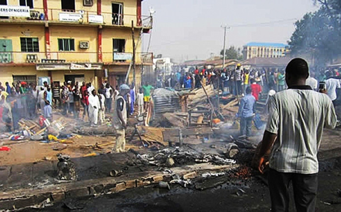FILE: Nigerians survey the scene of a bomb blast on 23 July 2014. Picture:EPA