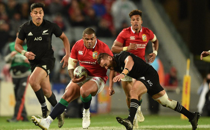 FILE: New Zealand's Aaron Cruden (R) tackles British and Irish Lions player Ken Owens (C) during their Test match. Picture: AFP