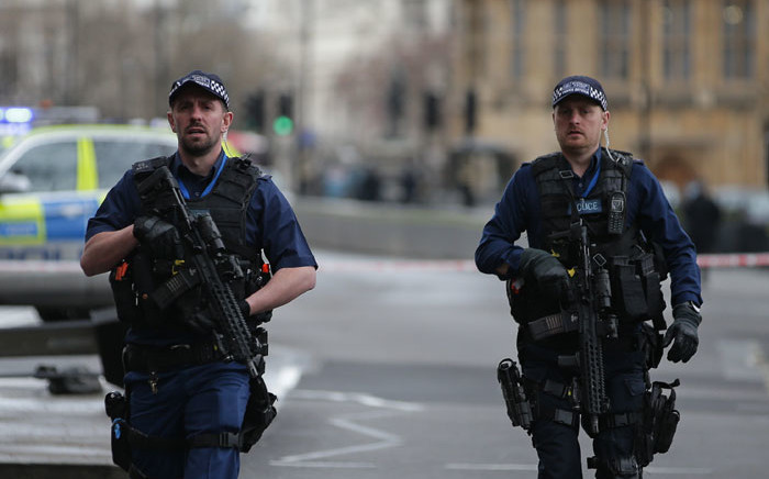 FILE: Armed British police patrol outside the Houses of Parliament in Westminster. Picture: AFP.